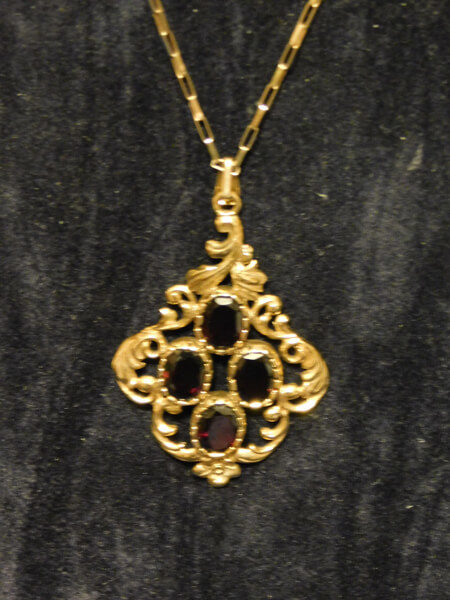 9ct. Gold Garnet Pendant and Chain